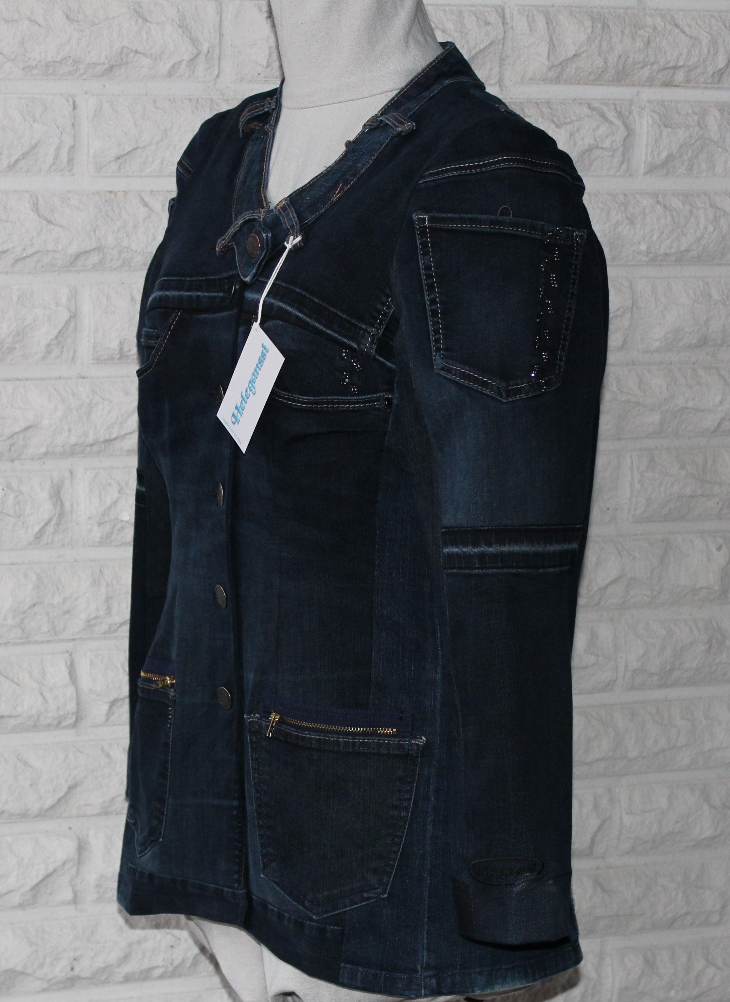 Tumman sävyinen jakku pidempänä mallina.